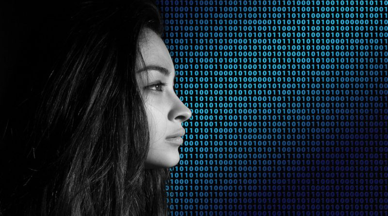 photo of woman in profile against Matrix-style wall of code