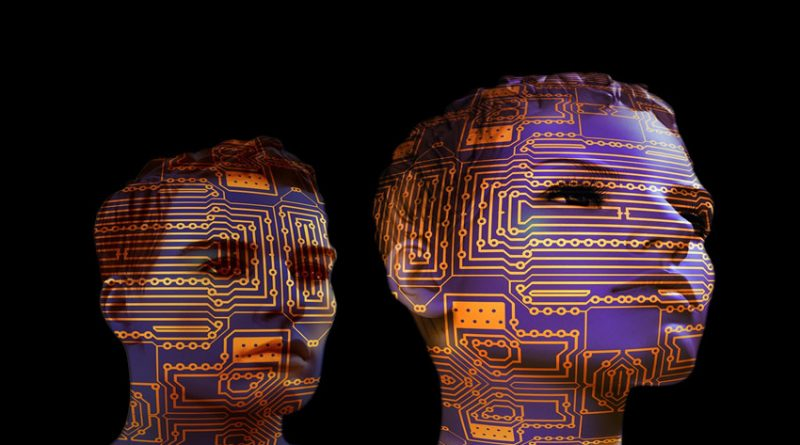 image of human head profiiles overlaid with circuit boards