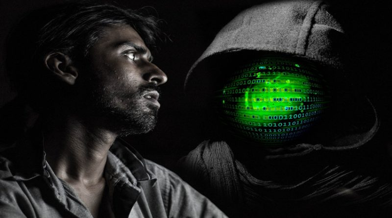 man looking at hooded face full of code