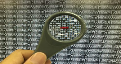 Magnifing glass looking at password hidden in computer code