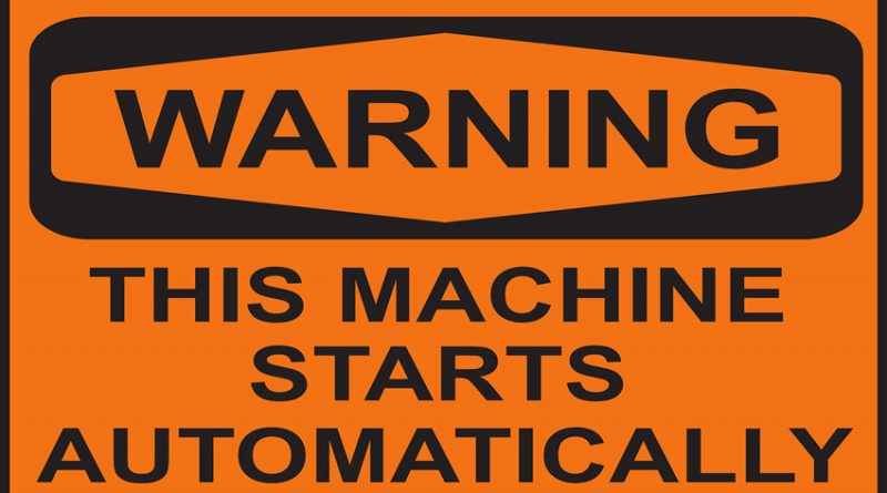warning sign saying this machine starts automatically