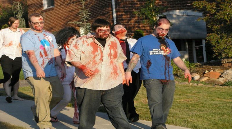 Group of nerds made up as zombies