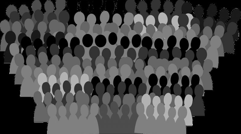 stylised image of a crowd using outline figures in black and white