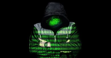 Image of hacker in shadows with code superimposed across body and face