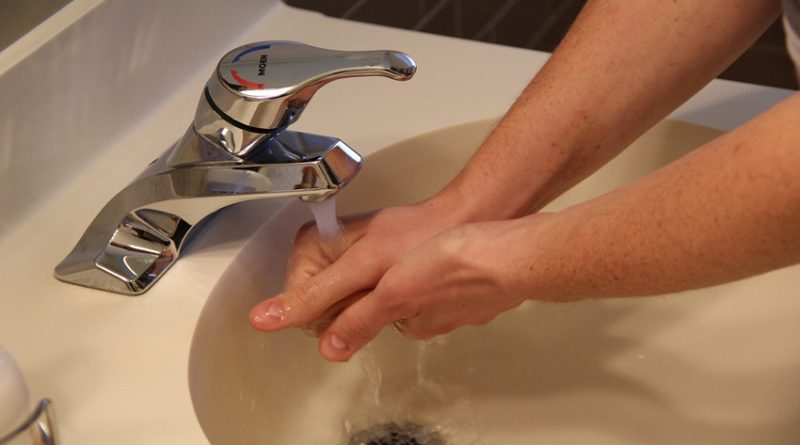 washing hands at sink