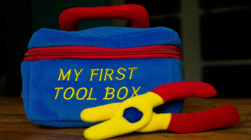 Picture of a toy toolbox and pliers