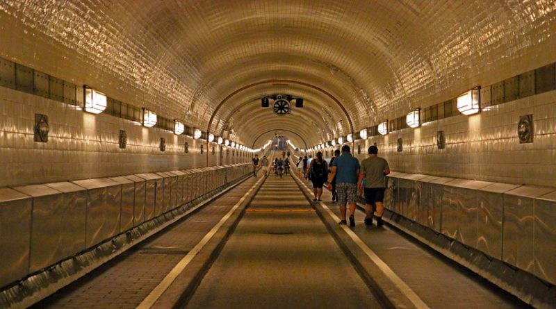 Photo of a tunnel with people walking through it