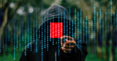 Hooded hacker against background of code