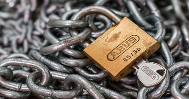 A pile of chain with a padlock showing