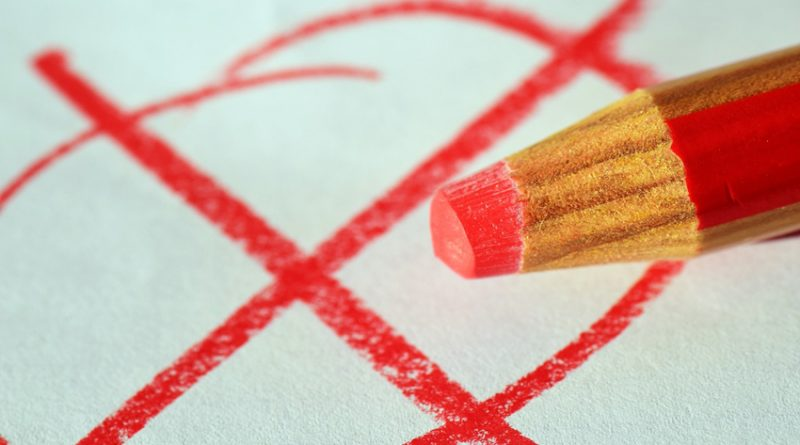Pencil marking a cross on a ballot paper