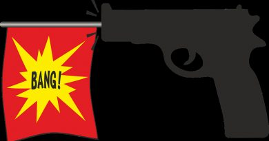 joke gun with bang flag