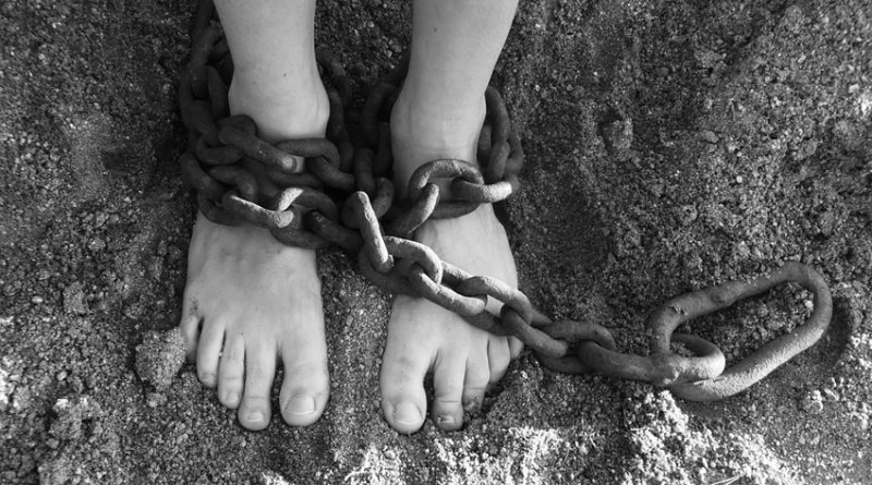 Someone's feet in chains