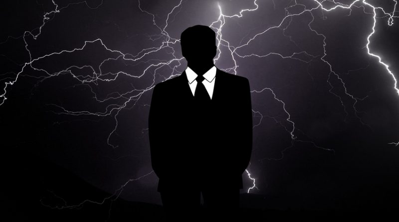 Image of a faceless businessman against a sinister dark background