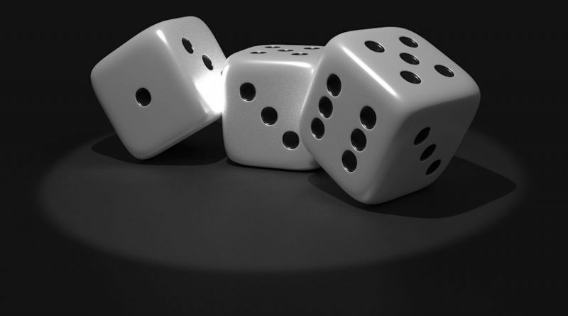 Three dice against a black background