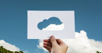 A cut out cloud template held up against real sky