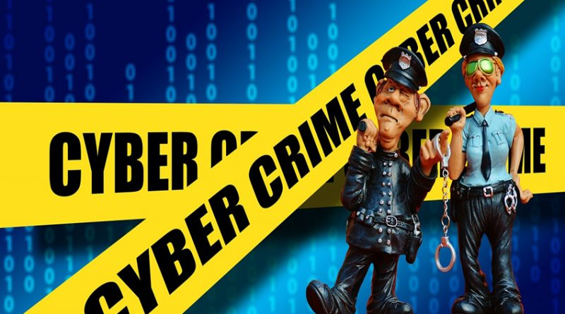 cartoon police in front of cyber crime tape