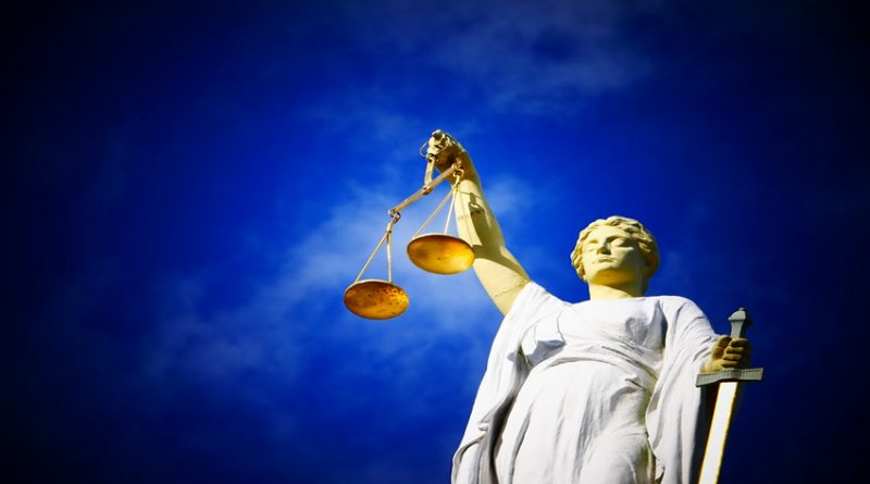 scales of justice against blue sky