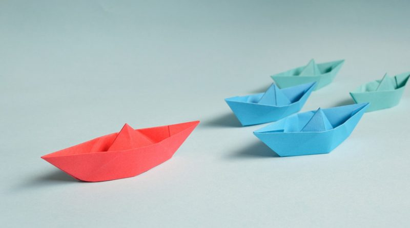 red and blue paper boats