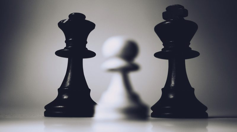 Three blurred chess pieces