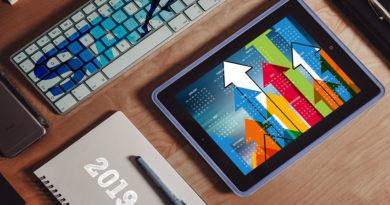 keyboard,calendar abd tablet with arrows on a desk
