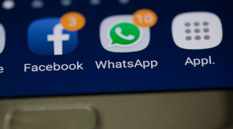 Facebook and WhatsApp icons on smartphone